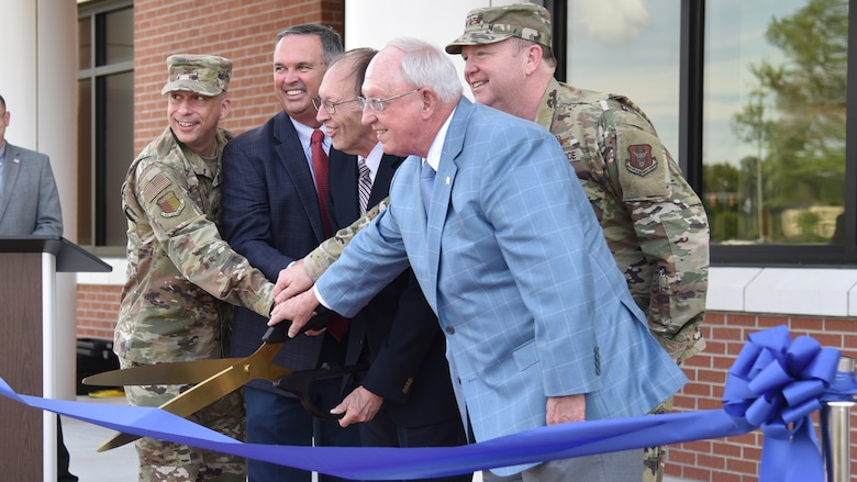 (From left to right) Col. Lyle Drew, 78th Air Base Wing commander, Warner Robins Mayor Randy Toms, retired Lt. Gen. Charles Stenner, Lt. Gen. Richard Scobee, commander of Air Force Reserve Command and Houston County Commissioners Chairman Tommy Stalnaker cut the ribbon during a ribbon cutting ceremony celebrating the completion of phase one of the consolidated mission complex June 25, on Robins Air Force Base in Georgia. Once completed the three-phase project will bring together 965 employees who are currently separated in nine different facilities. (U.S. Air Force photo by Misuzu Allen)