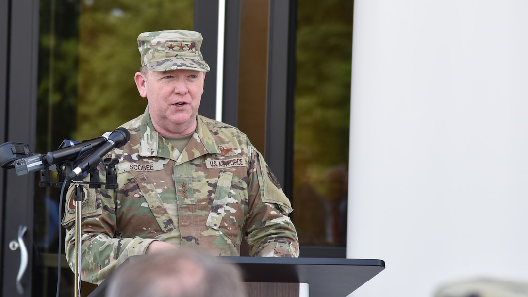 Lt. Gen. Richard Scobee, commander of Air Force Reserve Command, speaks during a ribbon cutting ceremony celebrating the completion of phase one of the consolidated mission complex June 25, on Robins Air Force Base in Georgia. Once completed the three-phase project will bring together 965 employees who are currently separated in nine different facilities. (U.S. Air Force photo by Misuzu Allen)