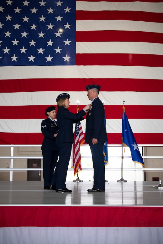 Col. Benjamin Spencer, 319th Air Base Wing commander, receives the Legion of Merit from Maj. Gen. Mary O'Brian, 25th Air Force commander, during a change of command ceremony June 28, 2019, on Grand Forks Air Force Base, North Dakota.
