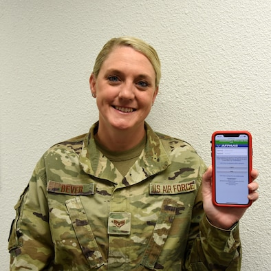 Staff Sgt. Ashley Bever, 403rd Force Support Squadron Non Commissioned Officer in charge of Installation Personnel Readiness, displays the Air Force Personnel Accountability and Assessment System, aka AFPAAS, website on a mobile phone June 28, 2019 at Keesler Air Force Base, Mississippi. AFPAAS is a notification system designed to inform Airmen and their families who are directly affected by major emergencies, such as hurricanes, fires, floods, earthquakes and evacuations due to these natural disasters or crisis events. (U.S. Air Force photo by Tech. Sgt. Christopher Carranza)