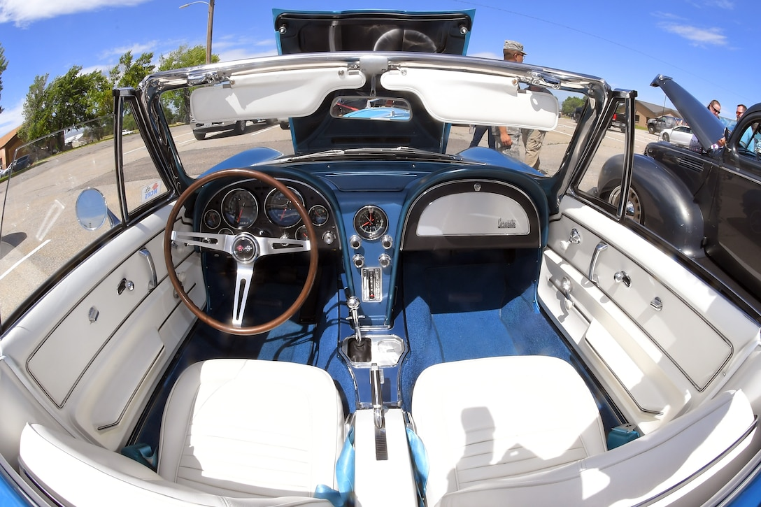 An interior view of a completely original 1967 Corvette convertible owned and restored by Jace Holt, F-16 System Program Office program manager, at a car show and barbecue hosted by the base's Foreign Military Sales organization at Hill Air Force Base, Utah, June 27, 2019. The event was a first for the unit and several program teams and employees displayed and shared details with visitors about their personally owned vehicles. (U.S. Air Force photo by Todd Cromar)