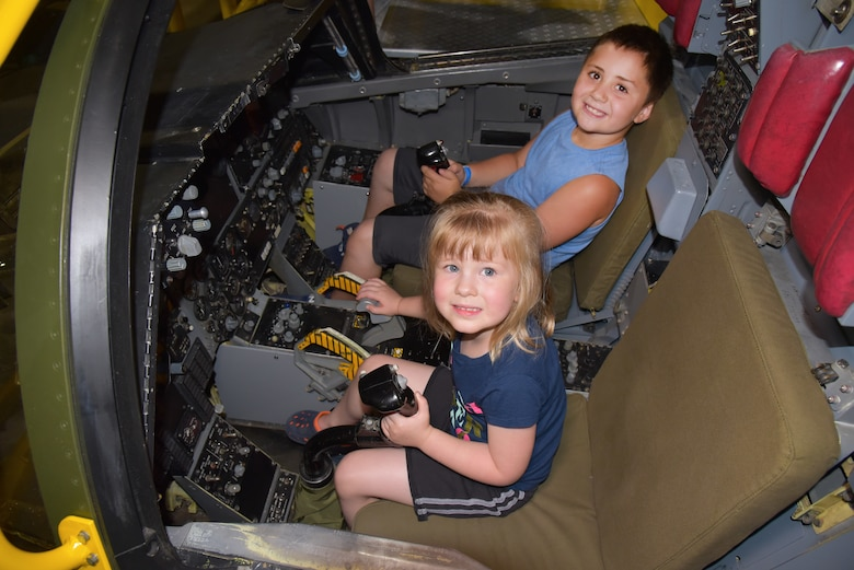 DAYTON, Ohio - Museum visitors enjoying the FB-111A Sit-in Cockpit in the Cold War Gallery at the National Museum of the U.S. Air Force. (U.S. Air Force photo)