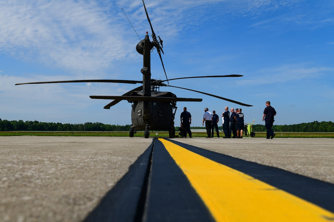 Youngstown Air Reserve Station firefighters receive training on engine shut-down procedures, emergency crew extraction and other safety concerns on the UH-60 Black Hawk helicopter on the aircraft ramp here June 26, 2019.