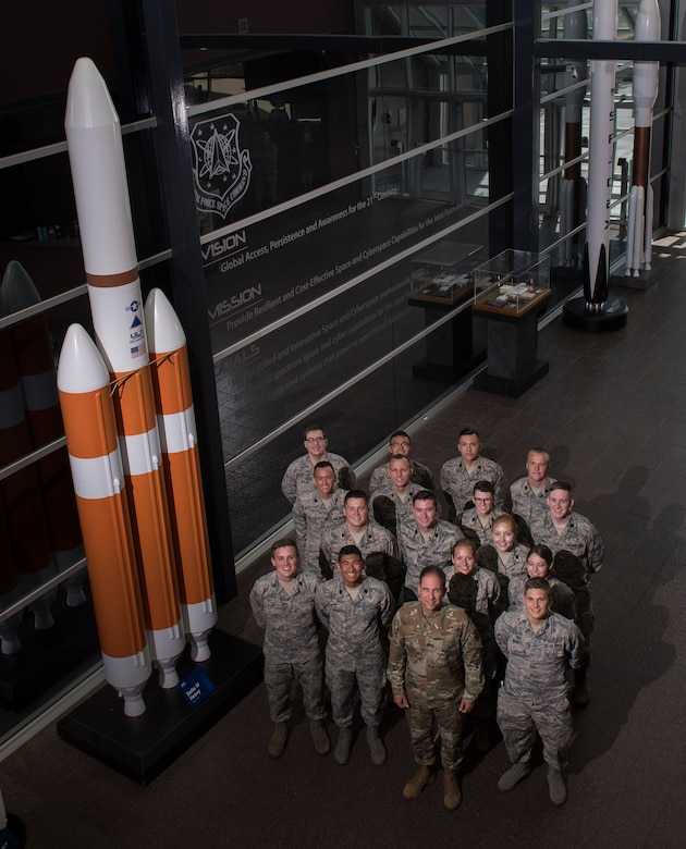 Maj. Gen. John Shaw, Air Force Space Command deputy commander (front center), stands with Reserve Officer Training Corps cadets during the inaugural AFROTC space immersion program, June 4, 2019, at Headquarters AFSPC. The program teaches cadets about AFSPC's space warfighting capabilities and provides opportunities for leadership development and mentorship. (U.S. Air Force photo by David Grim)