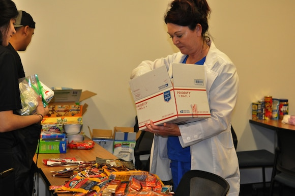 Nearly 50 students, family members and spouses created care packages at Chamberlain University June 20, 2019 in Las Vegas.