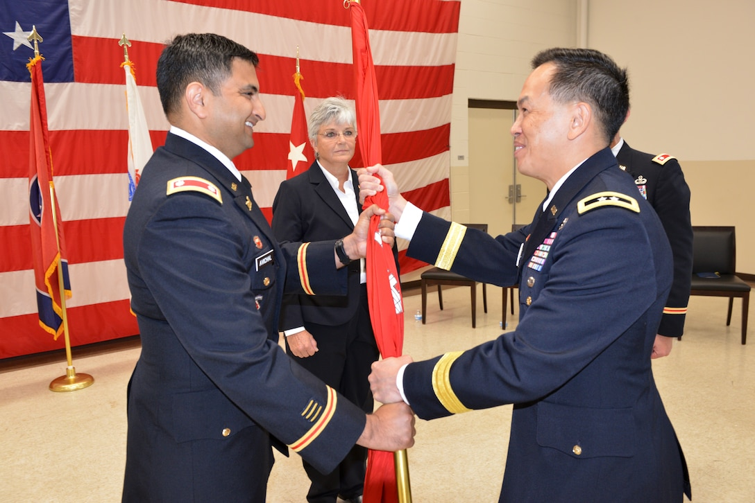 Maj. Gen. Mark Toy (Right), U.S. Army Corps of Engineers Great Lakes and Ohio River Division commander, passes the Corps of Engineers flag to Lt. Col. Sonny B. Avichal as he took command of the Nashville District during a change of command ceremony June 28, 2019 at the Tennessee National Guard Armory in Nashville, Tenn. (USACE photo by Mark Rankin)