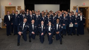 "The Whiteman Airman Leadership School Class 19-E gathers after their graduation ceremony at Whiteman Air Force Base, Missouri, June 27, 2019. Thier class motto was: ""What we do in life, echoes into eternity."" The nearly six-week course provides students with tools to effectively lead Airmen. (U.S. Air Force photo by Staff Sgt. Danielle Quilla)"