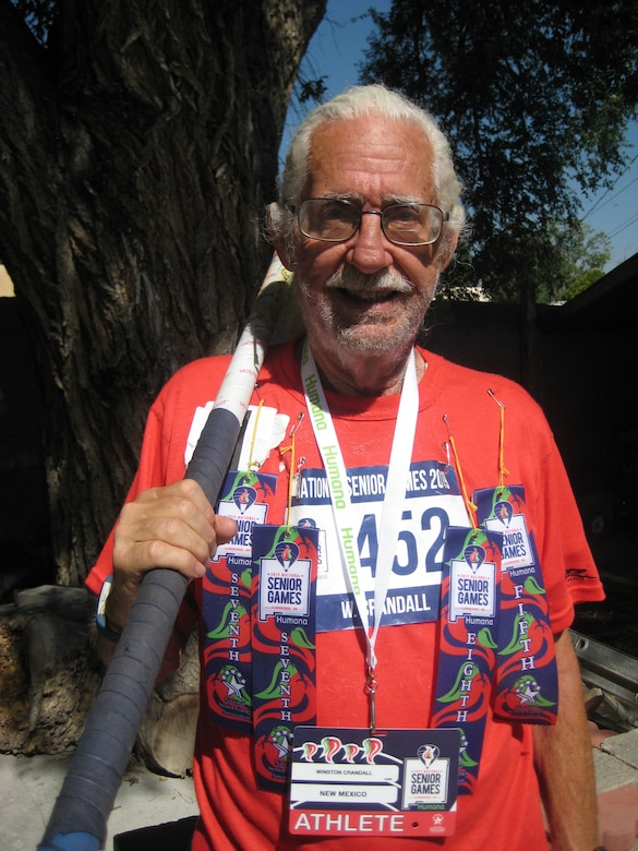 Retired Lt. Col. and former Team Kirtland member Winston Crandall displays his decorations for top-10 finishes at the National Senior Games June 22. The games, taking place in the Duke City from June 14 to 25, feature competition for people over 50 in 20 different sports. Many veterans and Albuquerque residents are taking part in the games, which have featured more than 13,700 athletes participating. Crandall, who served at Phillps Lab (now Air Force Research Laboratory New Mexico) toward the end of his Air Force career—he retired in 1992—has been an Albuquerque resident ever since. He competed and placed in the top 10 in the 75-79 age category in the Pole Vault, Men's 5,000- and 1,500-meter Race Walk, and Powerwalk. (Courtesy photo)