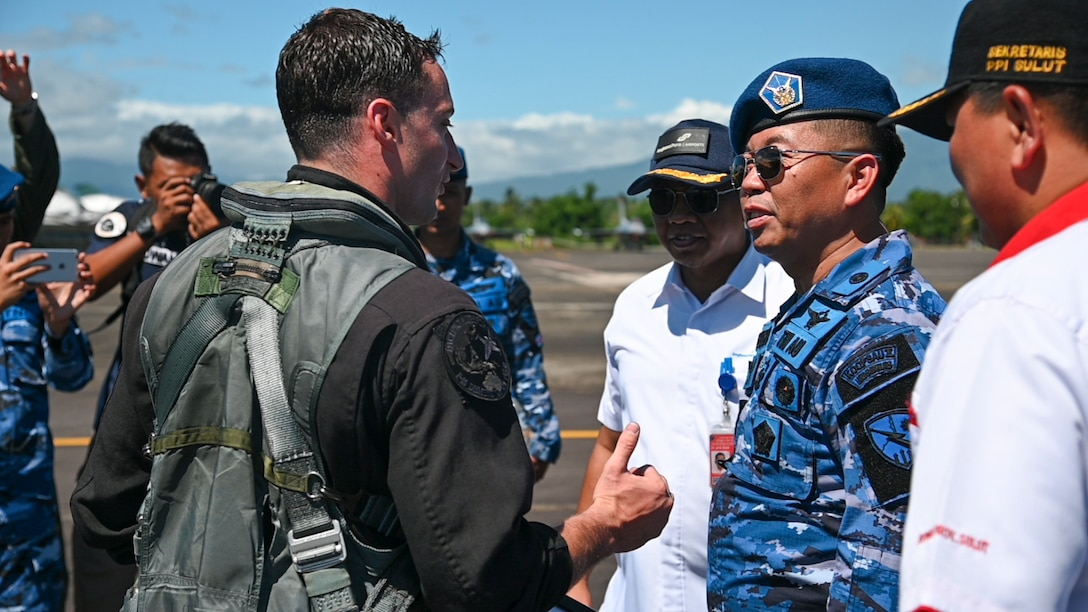"U.S. Air Force Capt. Jake ""Primo"" Impellizzeri, Pacific Air Forces' F-16 Demonstration Team commander, meets Indonesian armed forces leadership during the Cope West 19 open house at Sam Ratulangi International Airport, Manado, Indonesia June 22, 2019. Community relations events such as this provided the local populace an up-close and personal experience of the professionalism and collaboration their nation's military conducts alongside U.S. counterparts. (U.S. Air Force photo by Staff Sgt. Melanie A Hutto)"