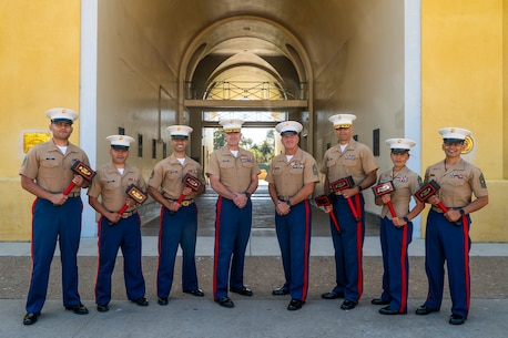U.S. Marines assigned to 12th Marine Corps District, Western Recruiting Region, pose for a photo after a recognition ceremony at Marine Corps Recruit Depot San Diego, Calif., June 28, 2019. The ceremony was held to recognize Marines who made an impact in their respective recruiting districts. (U.S. Marine Corps photo by Sgt. Christian Cachola)