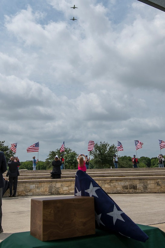"""A memorial service for Dr. Granville Coggs, a Documented Original Tuskegee Airman, was held on Friday, June 21, 2019 at Fort Sam Houston National Cemetery. The service culminated in a flyover conducted by two 99th Flying Training Squadron T-1A Jayhawks emblazoned with the """"Red Tails"""" associated with the Tuskegee Airmen.  (U.S. Air Force photo by: Tristin English)"""
