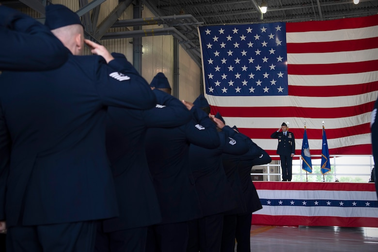 Col. Cameron Pringle, 319th Air Base Wing commander, recieves a first salute from the 319th Air Base Wing formation during a change of command ceremony for the wing June 28, 2019, on Grand Forks Air Force Base, North Dakota.