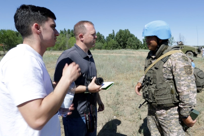 Spc. Gregory Thomson (far left), Utah Army National Guard, interprets for a media role player during cordon and search training with the Kazakhstani Ground Forces at Exercise Steppe Eagle 19 at Chilikemer Training Area near Almaty, Kazakhstan, June 25, 2019. Kazakhstan, the United States, the United Kingdom, Tajikistan, and Kyrgyzstan all sent participants for the exercise, while India, Turkey, and Uzbekistan sent observers. Steppe Eagle 19 is an annual U.S. Army Central-led exercise that promotes regional stability and interoperability in the Central and South Asia region.