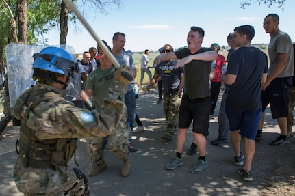 Spc. Chanson Hardy, Utah Army National Guard, (hands raised) shouts at a Tajikistani soldier during public order training as part of Exercise Steppe Eagle 19 at Chilikemer Training Area near Almaty, Kazakhstan, June 25, 2019. Kazakhstan, the United States, the United Kingdom, Tajikistan, and Kyrgyzstan all sent participants for the exercise, while India, Turkey, and Uzbekistan sent observers. Steppe Eagle 19 is an annual U.S. Army Central-led exercise that promotes regional stability and interoperability in the Central and South Asia region.