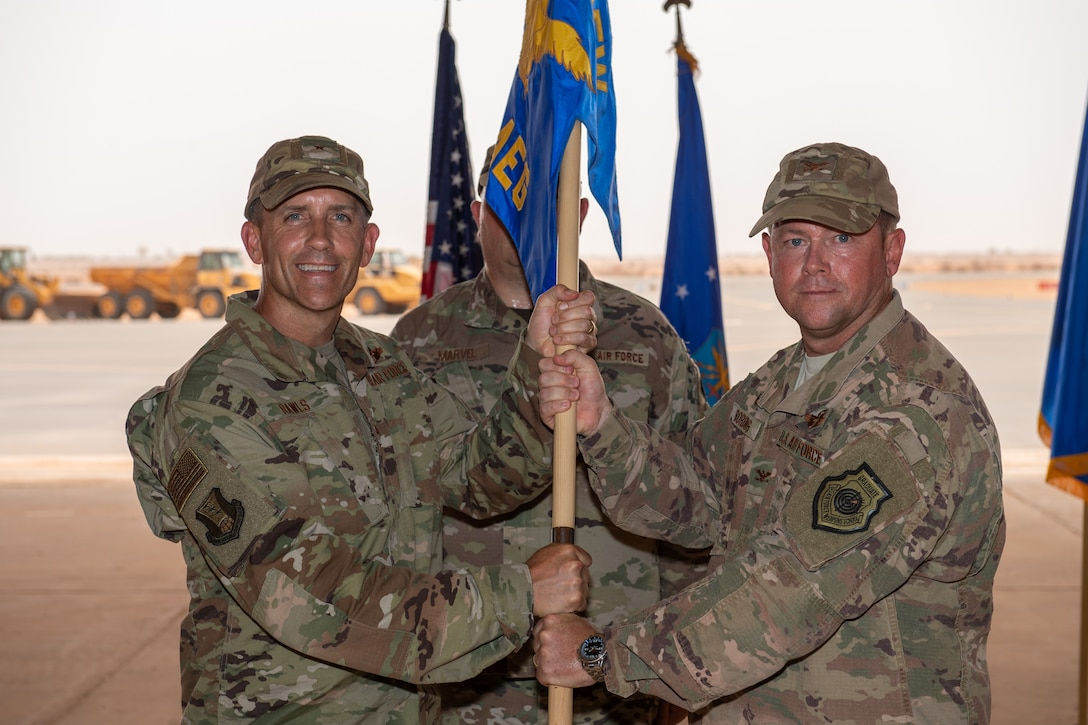 U.S. Air Force Col. Steven P. Bording, right, relinquishes command of the 409th Air Expeditionary Group with Brig. Gen. Michael T. Rawls, 435th Air Ground Operations Wing and 435th Air Expeditionary Wing commander, at Air Base 201, Niger, June 28, 2019. The 409th AEG is responsible for providing operations and integrated base operating support at three locations as part of the U.S. Africa Command counter-terrorism campaign in North and West Africa. (U.S. Air Force photo by Staff Sgt. Devin Boyer)