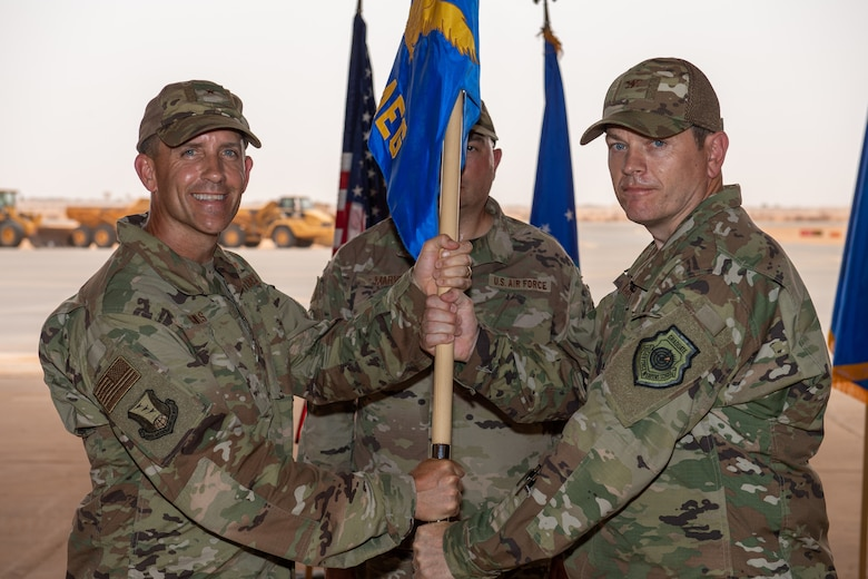 U.S. Air Force Col. Jonathan M. Creer, right, assumes command of the 409th Air Expeditionary Group with Brig. Gen. Michael T. Rawls, 435th Air Ground Operations Wing and 435th Air Expeditionary Wing commander, at Air Base 201, Niger, June 28, 2019. The passing of the guidon is a military tradition signifying the change of authority and responsibility of a unit from one commander to another. (U.S. Air Force photo by Staff Sgt. Devin Boyer)