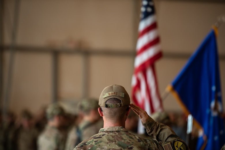 U.S. Air Force 1st Lt. Michael Hart, 724th Expeditionary Air Base Squadron logistics readiness flight commander, salutes the American flag during the 409th Air Expeditionary Group change of command ceremony at Air Base 201, Niger, June 28, 2019. The change of command recognized Col. Steven P. Bording for his leadership, and welcomed the new commander, Col. Jonathan M. Creer. (U.S. Air Force photo by Staff Sgt. Devin Boyer)