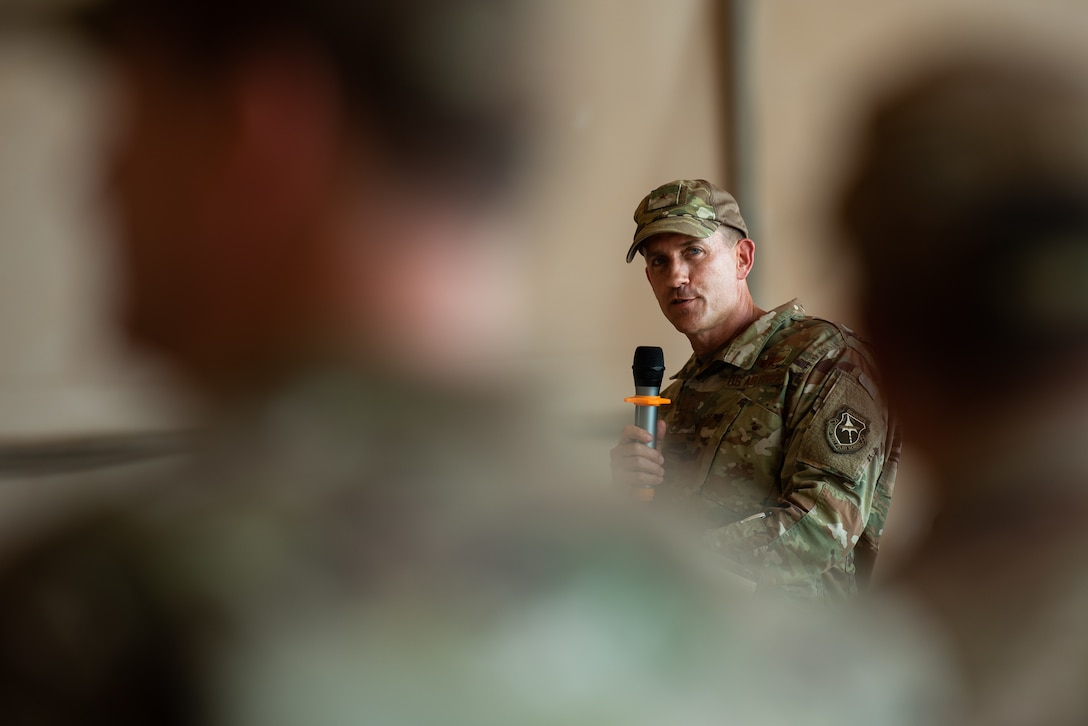 U.S. Air Force Brig. Gen. Michael T. Rawls, 435th Air Ground Operations Wing and 435th Air Expeditionary Wing commander, gives a speech during the 409th Air Expeditionary Group change of command ceremony at Air Base 201, Niger, June 28, 2019. Rawls spoke about the tremendous accomplishments and hurdles the commanders and their Airmen overcame to keep the base running in an austere environment. (U.S. Air Force photo by Staff Sgt. Devin Boyer)