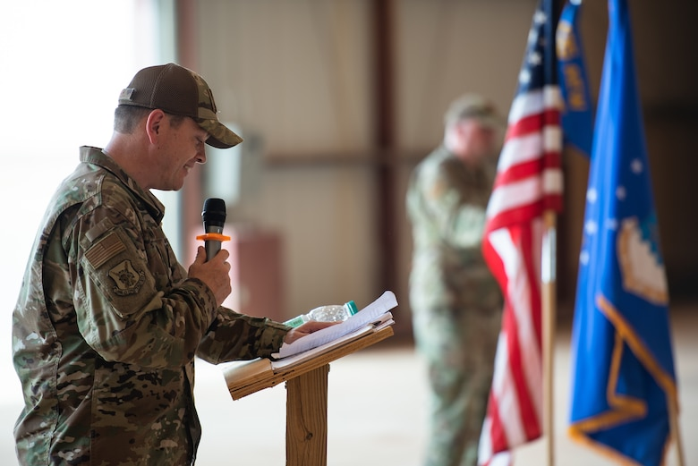 U.S. Air Force Col. Steven P. Bording, 409th Air Expeditionary Group commander, gives his first speech to the group during the change of command ceremony at Air Base 201, Niger, June 28, 2019. After Creer's remarks, he gave his first salute to the group. (U.S. Air Force photo by Staff Sgt. Devin Boyer)