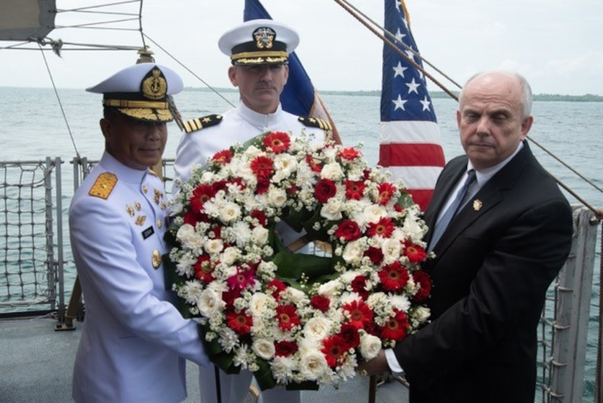 U.S. Ambassador to Indonesia Joseph Donovan Jr. (right), Cmdr. Greg Adams (center), Naval Attaché of U.S. Embassy Jakarta, and a senior leader of the Indonesian Navy (TNI-AL) prepare to lay a wreath during a memorial service aboard the Indonesian Navy ship Kri Usman Harun (359). The ceremony was held to honor the American and Australian crews of USS Houston (CA 30) and HMAS Perth (D 29) that lost their lives in battle against the Japanese Imperial Navy during World War II.