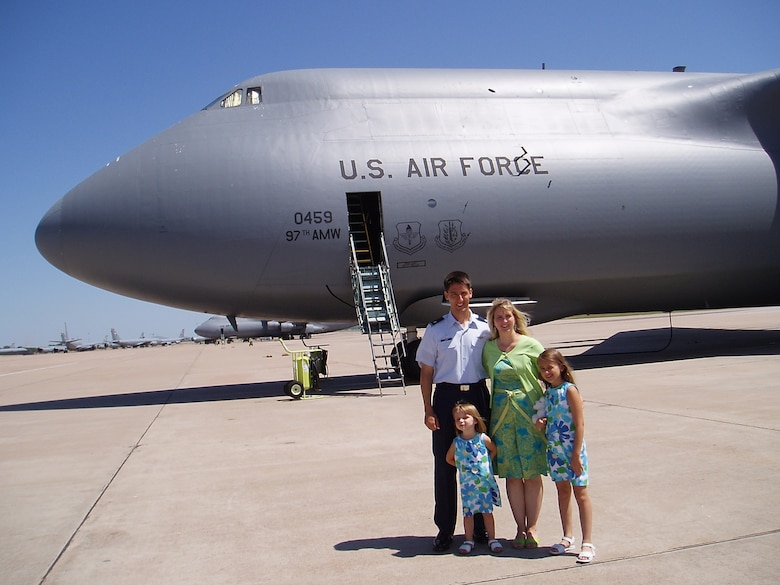 Then Lt. Col. Kyle J. Kremer, former 56th Airlift Squadron commander, and his family stand in front of a C-5 Galaxy at the 97th Air Mobility Wing in 2005, Altus Air Force Base, Okla. Now Brig. Gen. Kremer is the Director, Global Reach Programs, Office of the Assistant Secretary of the Air Force for Acquisition, Headquarters U.S. Air Force, Arlington, Virginia. (Courtesy photo by Brig. Gen. Kyle J. Kremer)