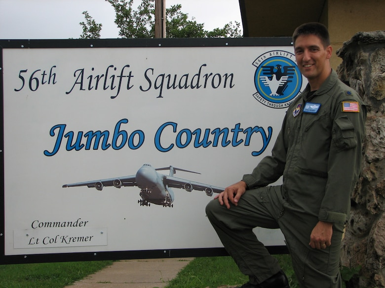 Then Lt. Col. Kyle J. Kremer, former 56th Airlift Squadron commander, stands in front of the 56th AS sign at the 97th Air Mobility Wing in 2007, Altus Air Force Base, Okla. Now Brig. Gen. Kremer is the Director, Global Reach Programs, Office of the Assistant Secretary of the Air Force for Acquisition, Headquarters U.S. Air Force, Arlington, Virginia. (Courtesy photo by Brig. Gen. Kyle J. Kremer)