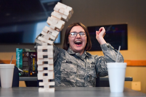 Staff Sgt. Rachael Avery, 50th Contracting Squadron contracting specialist, celebrates winning a game of Jenga during the Lunch Box Games at Building 300 Auditorium at Schriever Air Force Base, Colorado, Feb. 26, 2019. The 50th Space Wing Chaplain's office hosts the Lunch Box games every other Tuesday. (U.S. Air Force photo by Katie Calvert)