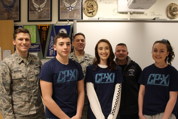 Hanscom Air Force Base mentors 2nd Lt. Gregory Barrow, and retired Lt. Col. Ken Mierz, and retired Master Sgt. Charlie Humphrey pose with CyberPatriot competitors Cadet Col. Cameron Edens, left, Cadet Col. Mak Marrs, center, and Cadet Staff Sgt. Avree Dillingham, from Bedford High School, Bedford, Mass., Feb. 25. CyberPatriot is an Air Force Association-sponsored program designed to train middle- and high-school students in network operations and security. This was the first year Hanscom mentored teams. (U.S. Air Force photo courtesy of 2nd Lt. Gregory Barrow)