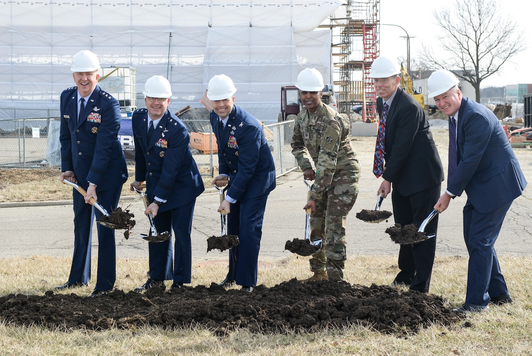 Members of Wright-Patterson Air Force Base Leadership participate in a ground breaking ceremony for the first-ever shared Above-Secret Department of Defense super computer facility at Wright-Patterson Air Force Base, Ohio, Feb. 26, 2019.