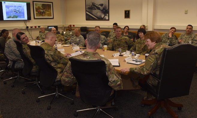 48th Medical Group personnel speak with Lt. Gen. Dorothy A. Hogg, U.S. Air Force surgeon general, at Royal Air Force Lakenheath, England, Feb. 28, 2019. Airmen highlighted the importance of the 48th MDG's mission to support readiness and to improve interoperability and clinical skills. (U.S. Air Force photo by Airman 1st Class Madeline Herzog)