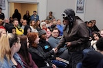Gigi Coleman works the crowd as her great aunt and daredevil pilot Bessie Coleman during a Black History Month event at DLA Disposition Services headquarters in Michigan Feb. 28.