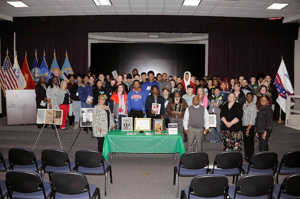 Battle Creek Central High School students pose with educator Gigi Coleman during a Black History Month program at the Hart-Dole-Inouye Federal Center in Battle Creek, Michigan, Feb. 28.