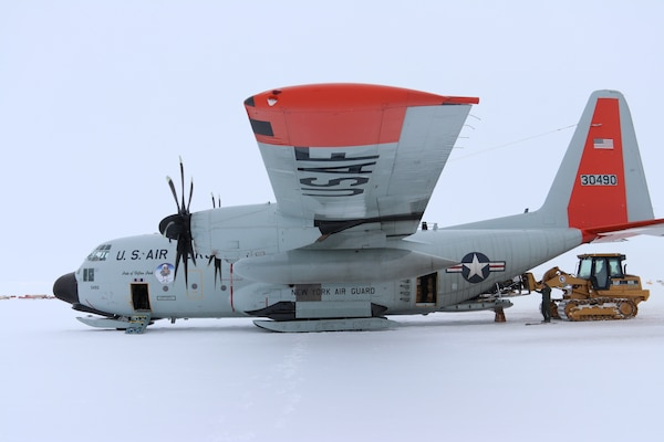 Members of the New York Air National Guard's 109th Airlift Wing load cargo onto an LC-130, ski-equipped aircraft at McMurdo Station, Antarctica on January 15, 2019.
