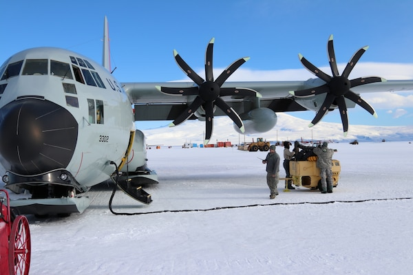 A member of the New York Air National Guard's 109th Airlift Wing performs maintenance on an LC-130, ski-equipped aircraft at McMurdo Station, Antarctica on December 17, 2018