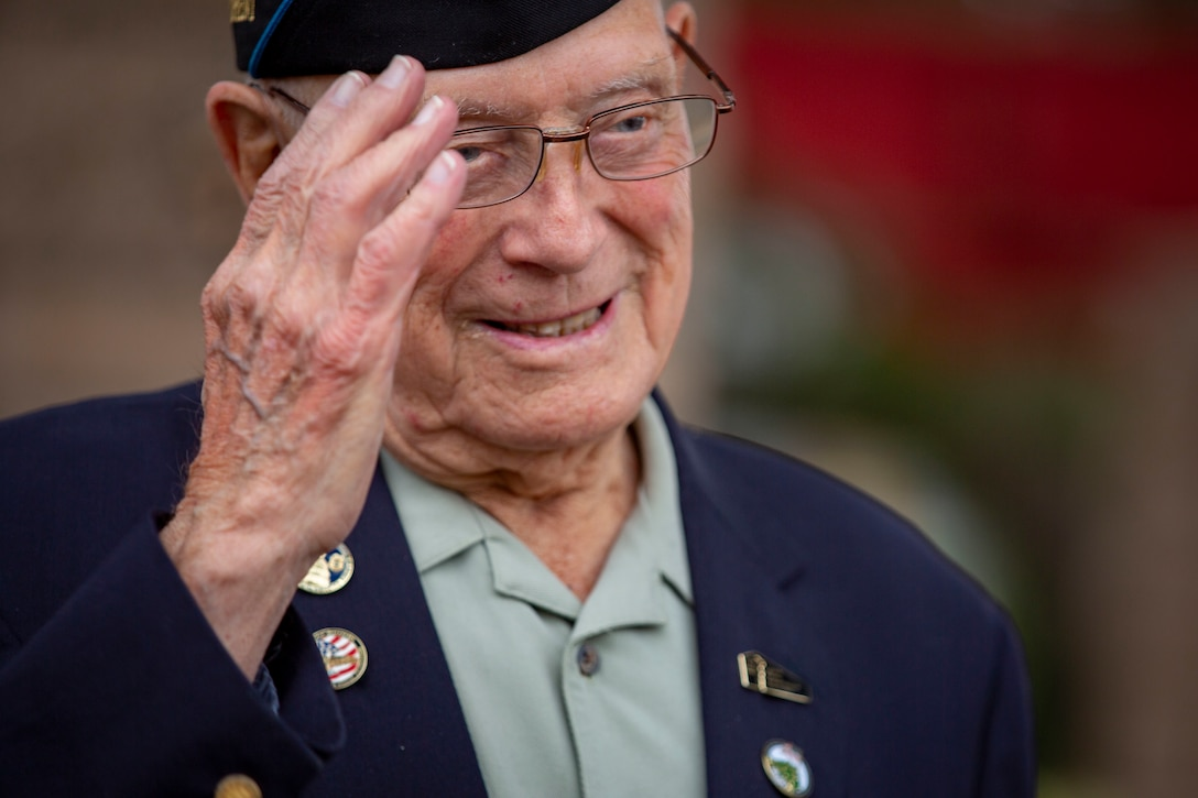 A retired Marine salutes.