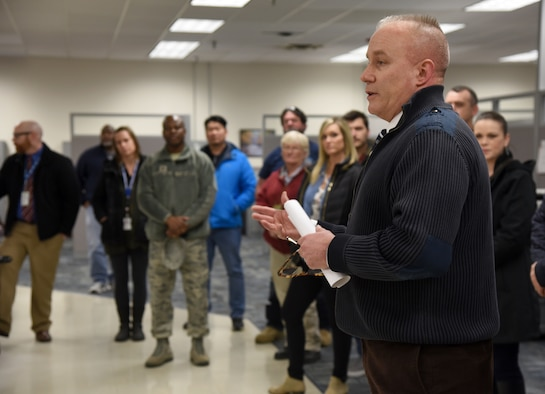 Jerome Smith, chief of the Personal Property Processing Office, speaks with members of Team Tinker about Art of the Possible processes and continuous process improvements the Personal Property Processing Office has gone through Feb. 22. About 30 people from across the base toured various sections of the 72nd Logistics Readiness Squadron as part of an ongoing initiative to showcase various organizations within the 72nd Air Base Wing. (U.S. Air Force photos/Kelly White)