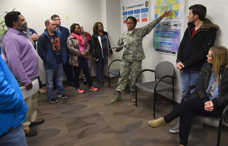 Staff Sgt. Chaelon Moultry, with the 72nd Logistics Readiness Squadron Passenger Movement Office, speaks about how her office helps over 26,000 DoD military and civilians and 18,000 dependents annually. About 30 people from across the base toured various sections of the 72nd Logistics Readiness Squadron as part of an ongoing initiative to showcase various organizations within the 72nd Air Base Wing. (U.S. Air Force photos/Kelly White)