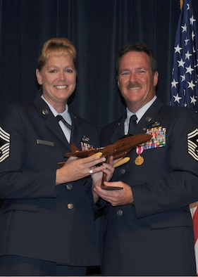 A photo of Ret. Chief Master Sgt. Gail Hargis and her husband Ret. Chief Master Sgt.