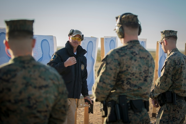 U.S. Marines with the Provost Marshal's Office (PMO), Headquarters and Headquarters Squadron (H&HS), Marine Corps Air Station (MCAS) Yuma, engage targets during a law enforcement (LE) range qualification on MCAS Yuma Ariz., Feb. 28, 2019. The LE qualification is specific to military police personnel, including several different shooting methods with both the Beretta M9 pistol and Benelli 12 gauage shotgun. (U.S. Marine Corps photo by Sgt. Allison Lotz)