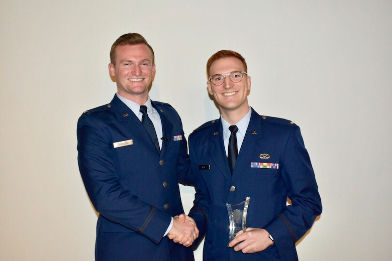 From left, 1st Lt. Tim Sobieski of the 627th Air Base Group and 2nd Lt Alexander Bow, 627th Civil Engineer Squadron, both at JB-Lewis-McChord, Washington, pose with their trophy after winning second place in the first AFIMSC Innovation Rodeo. During the event, the lieutenants pitched an idea by Bow and Capt. Gregory Hege, currently deployed to Air Force Central Command, Al Udeid, Qatar. The idea is to leverage existing Geospatial Information System AI learning for Facility Roof Inspections. The team finished second in the event. (U.S. Air Force photo by Armando Perez)