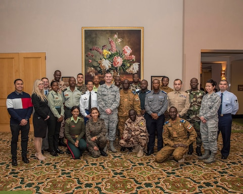 A group of international officers and senior non-commissioned officers from ten Nations within the United States African Command area of responsibility pose for a photo with members of the 960th Cyberspace Wing at the Gateway Club at Joint Base San Antonio, Texas, Feb. 28.