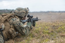 A U.S. Marine with 2nd Battalion, 2nd Marine Regiment, 2nd Marine Division fires a M27 Infantry Assault Rifle (IAR) while conducting combined-armed assaults on Training Landing Zone (TLZ) Flamingo, Camp Lejeune, N.C., Feb. 28, 2019. This training incorporates squad-sized attacks from multiple combat elements to maintain mission readiness and enhance operational effectiveness. (U.S. Marine Corps photo by Lance Cpl. Nathaniel Q. Hamilton)
