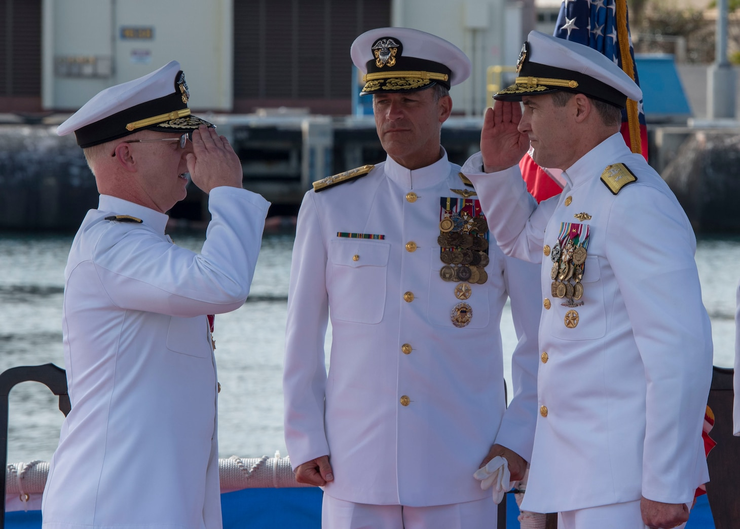 Rear Adm. Blake Converse, right, relieves Rear Adm. Daryl L. Caudle, left, as the commander of Submarine Force, U.S. Pacific Fleet during a change of command ceremony aboard the Virginia-class fast attack submarine USS Mississippi (SSN 782) in Joint Base Pearl Harbor-Hickam. (U.S. Navy photo by Mass Communication Specialist 2nd Class Shaun Griffin/Released)