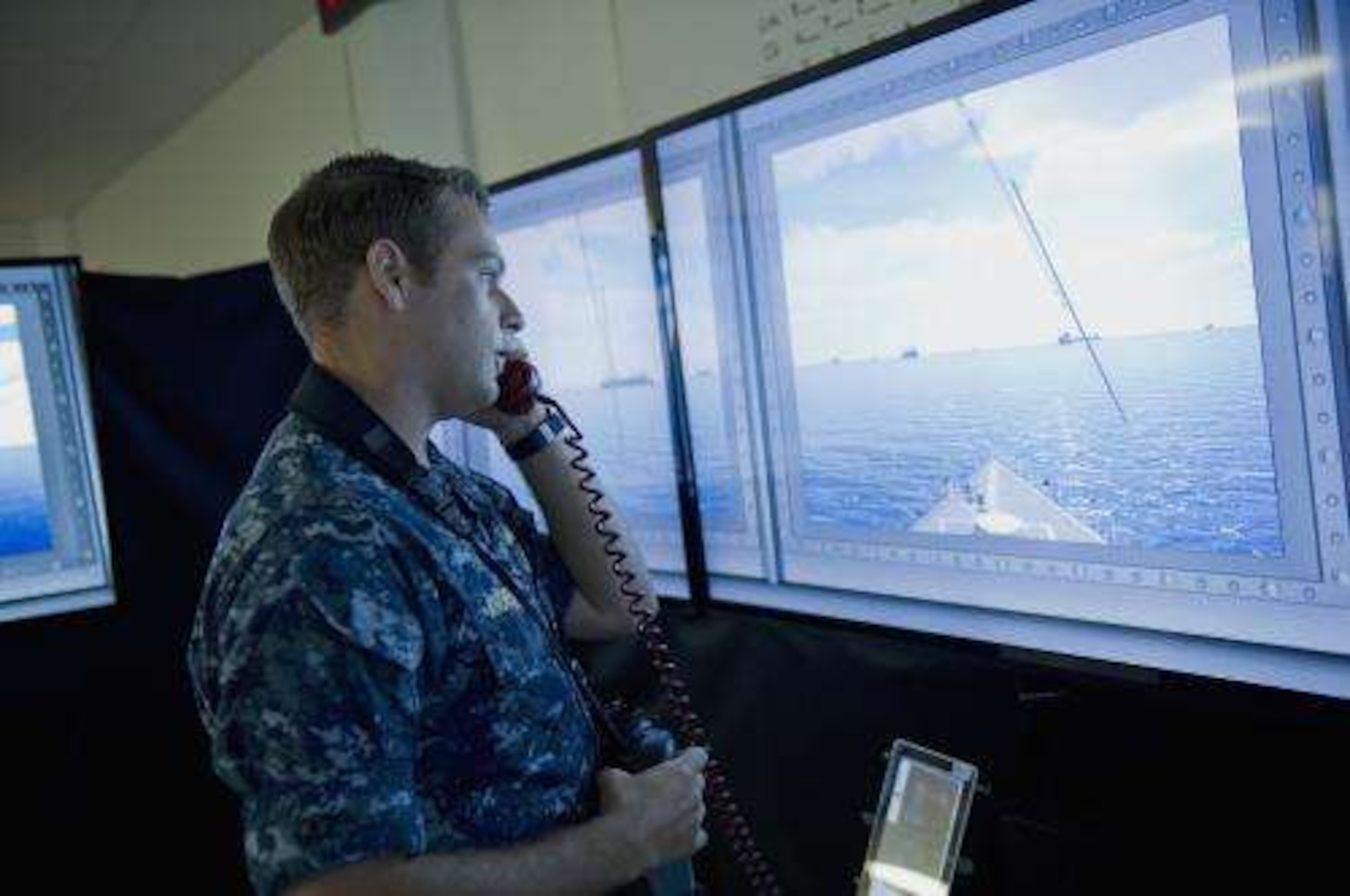 File photo: of a Navy officer standing the officer of the deck watch in the Office of Naval Research Fleet Integrated Synthetic Training and Testing Facility (FIST2FAC), which allows Sailors to interact with artificially intelligent synthetic forces in verious settings.