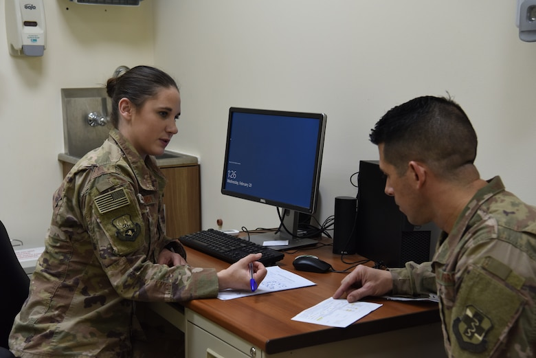 Staff Sgt. Casey Gasbarro, 380th Expeditionary Medical Group flight and operational medical technician, examine a simulated patient's evaluation during the public health exercise at Al Dhafra Air Base, United Arab Emirates, Feb 18-22, 2019.