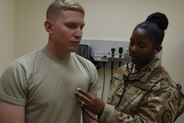 Tech. Sgt. Johnetta Young, 380th Expeditionary Medical Group independent medical technician, performs an evaluation of a simulated patient during the public health exercise at Al Dhafra Air Base, United Arab Emirates, Feb 18-22, 2019.