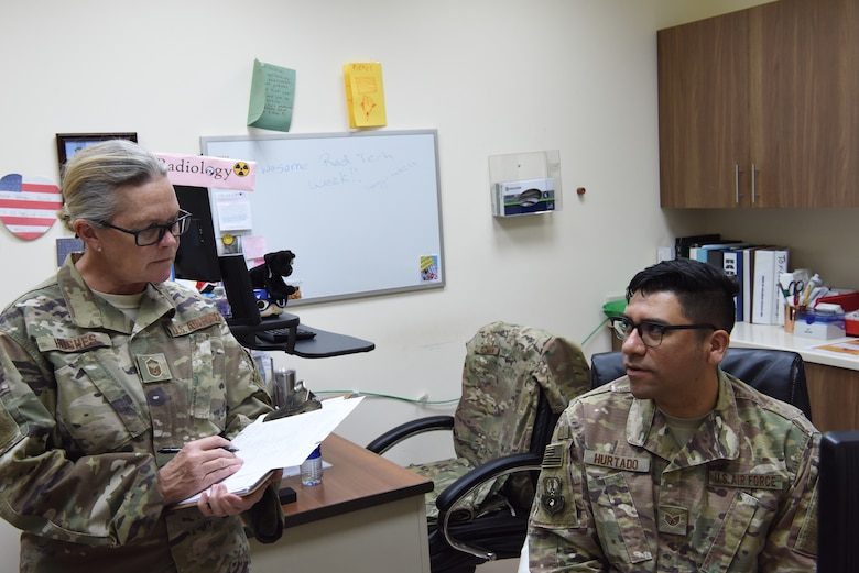 Senior Master Sgt. Patricia Hughes, 380th Expeditionary Medical Group superintendent of public health and evaluator, asks questions to Staff Sgt. Vincent Hurtado, 380th EMDG laboratory technician, as part of the public health exercise at Al Dhafra Air Base, United Arab Emirates, Feb 18-22, 2019.