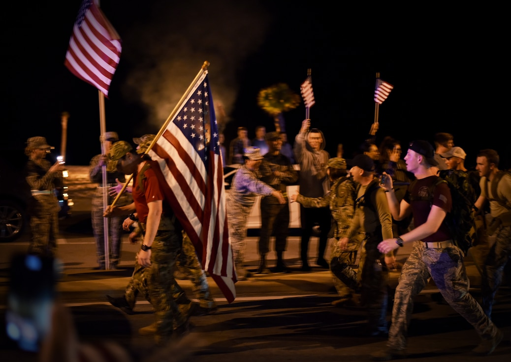 Airmen from the 352nd Battlefield Airmen Training Squadron, Second Air Force and 81st Training Wing leadership join a team of Special Tactics Airmen ruck marching through Biloxi, Mississippi March 1, 2019. Twenty Special Tactics Airmen ruck from Medina Annex at Lackland Air Force Base, Texas, to Hurlburt Field, Florida, to pay tribute to Staff Sgt. Dylan J. Elchin, who was killed in Afghanistan on Nov. 27, 2018, and 19 other Special Tactics Airmen who have been killed in action since 9/11. The ruck march takes ST members across five states and 830 miles. (U.S. Air Force photo by Master Sgt. Ryan Crane)