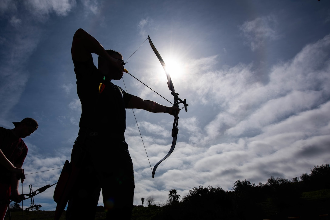 British Royal Marine Jack Agu participates in archery during the 2019 Marine Corps Trials at Marine Corps Base Camp Pendleton, California, Feb. 28. The Marine Corps Trials promotes recovery and rehabilitation through adaptive sports participation and develops camaraderie among recovering service members and veterans.