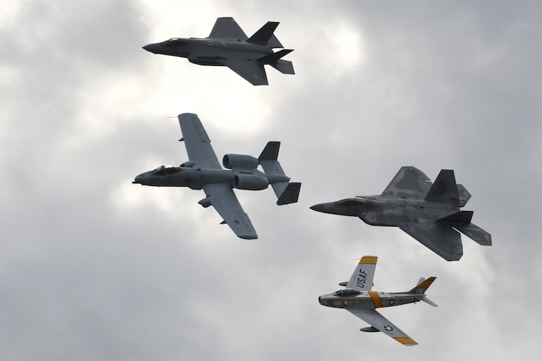 A U.S. Air Force A-10 Thunderbolt II, F-22 Raptor, F-35 Lightning and an F-86 Sabre fly in formation together over Davis-Monthan Air Force Base, Ariz., March 2, 2019.